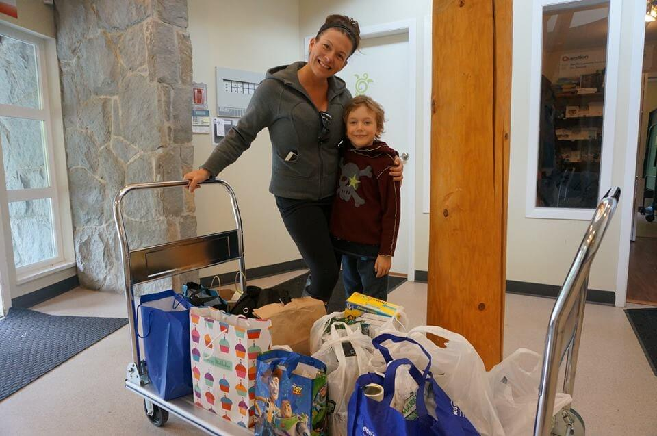 My daughter Tyla and Grandson Ben donating the Food Bank donations Ben received in leu of presents for his birthday.