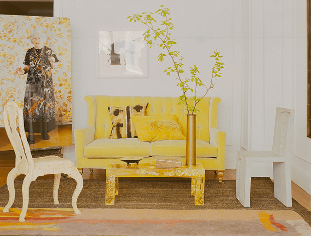 Image from Johnson's NY Apartment courtesy of Elle Decor. Note the mix of French Provincial, 60's style coffee table, and canary yellow  arts and crafts settee flanked by original photograph by Anna-Aaija Aarras